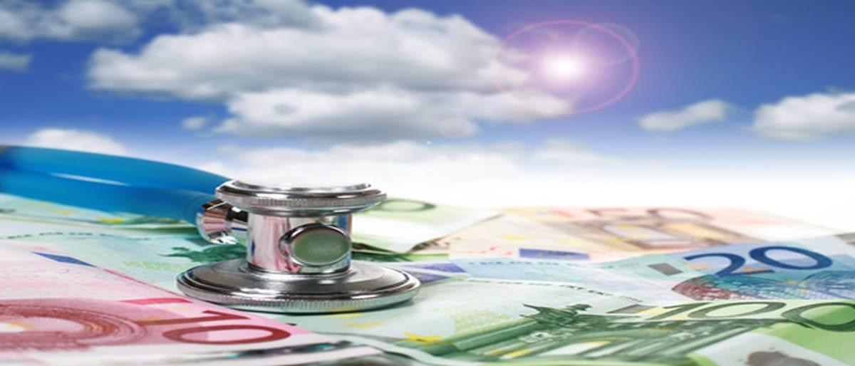 Blue stethoscope is over euro money background.